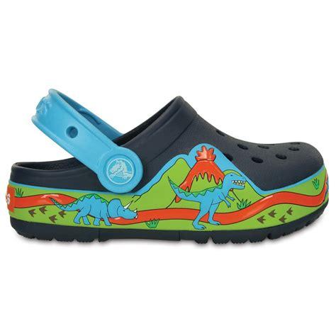 light up crocs crocs lights dinosaur clog navy volt green with