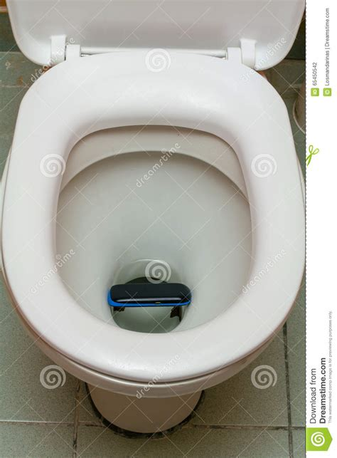 phone fell in toilet mobile phone in the toilet stock photo image 65450542