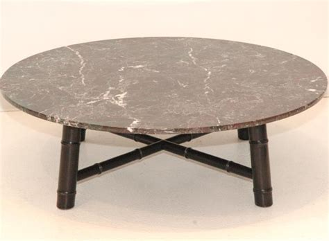 a custom marble cocktail table attributed to robsjohn