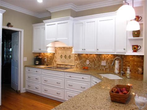 pictures of kitchens with white cabinets and black countertops chocolate truffle caramel tea leaves and white great 9945