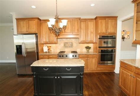oak cabinets and black painted island kitchens