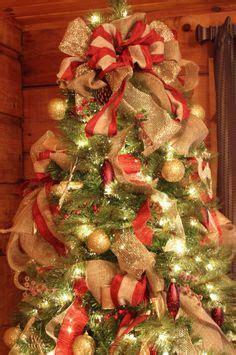 put ribbon   christmas tree  decorating