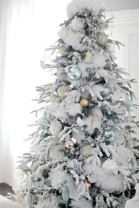 fluffy snowy tree  pastel ornaments christmas decor