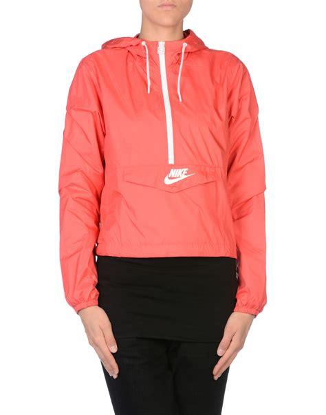 nike light pink windbreaker nike jacket in pink coral lyst