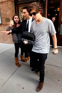 Harry Styles looks pleased with himself as he leaves ...