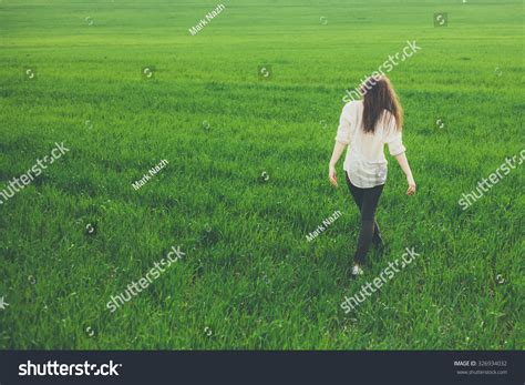 Unrecognizable Lonely Sad Girl Walking On Summer Meadow
