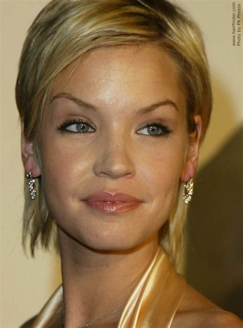 Ashley Scott   Neck length short hair colored to bring out
