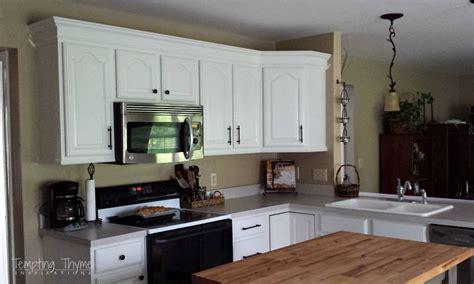 adding height to kitchen cabinets adding height to the kitchen cabinets tempting thyme 7407