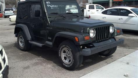 tan jeep wrangler 2 door green tan cloth interior 2 5 liter 4 cylinder 5 speed