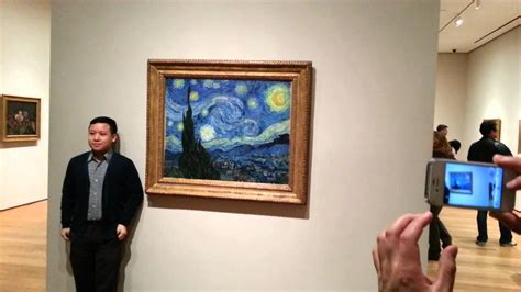 tourist bangs vincent gogh starry at the metropolitan museum of modern moma