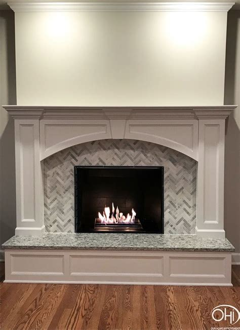 fireplace  wood panels herringbone tile