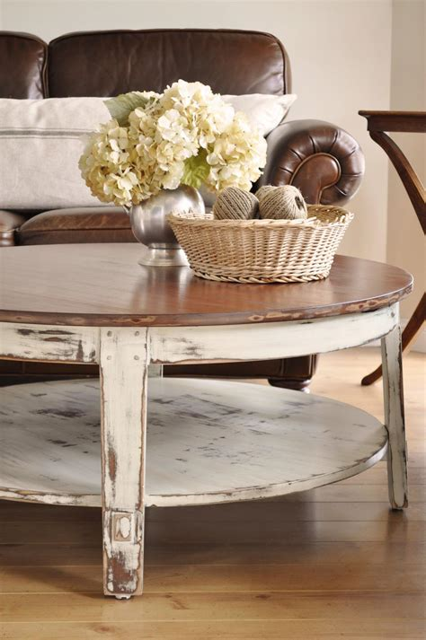 While decorating a round coffee table, many people suggest grouping objects into a triangular shape. Painted Coffee Table is Like Modern Fashion | Coffee Table Design Ideas