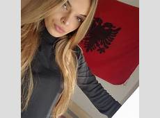 Beautiful Albanian girl, blonde, Albanian flag, red and black
