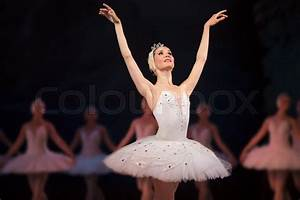 Prima ballerina white swan on stage dancing gracefully ...