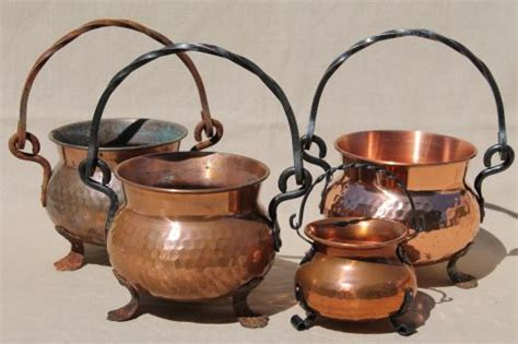 hammered copper kettles lot collection  small cauldron pots  wrought iron handles