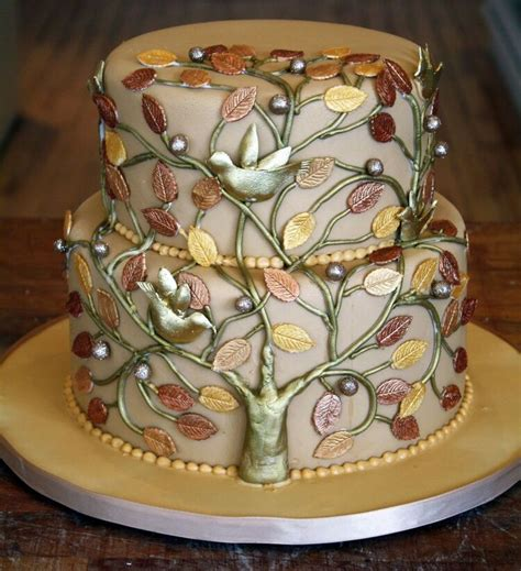 taupe cake copper trunk gold  silver leaves pop