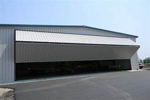 aerial spraying operations are on fast track with schweiss With bifold hangar doors