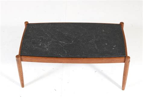 Check out our mid century modern coffee table selection for the very best in unique or custom, handmade pieces from our coffee & end tables shops. Oak Belgium Mid-Century Modern Coffee Table with Slate Top, 1960s For Sale at 1stdibs