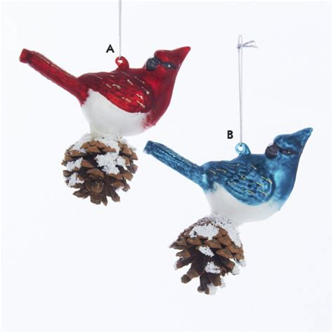 red and blue glass cardinal with pinecone decorative