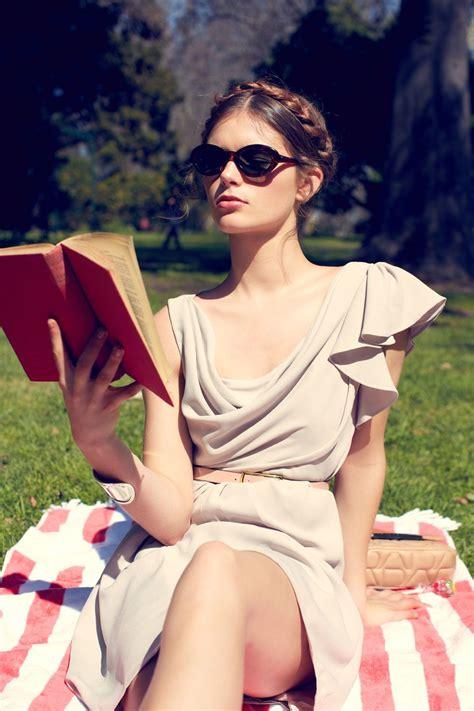 model brings book  slow times  photo shoot
