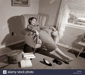 1950s EXHAUSTED FEMALE SLUMPED IN CHAIR WITH SHOES OFF ...
