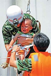 Rescuers Save A Child Trapped By Floods In Benxi  Liaoning