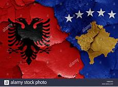 flags of Albania and Kosovo painted on cracked wall Stock