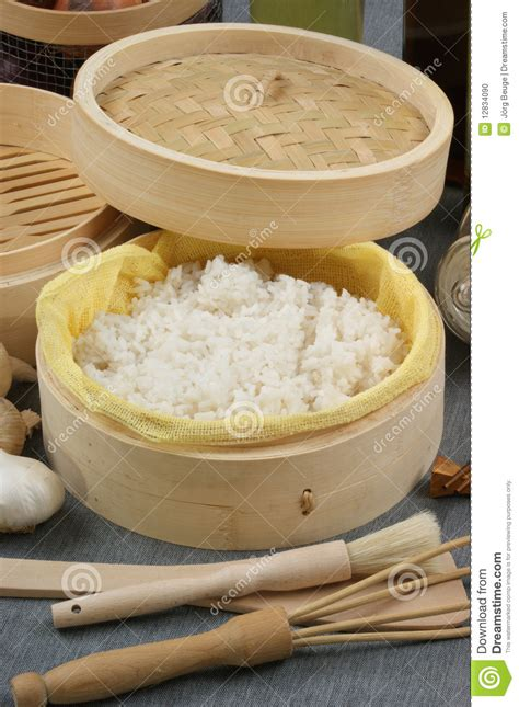 how to steam rice steamed rice in a bamboo steamer stock photo image 12834090