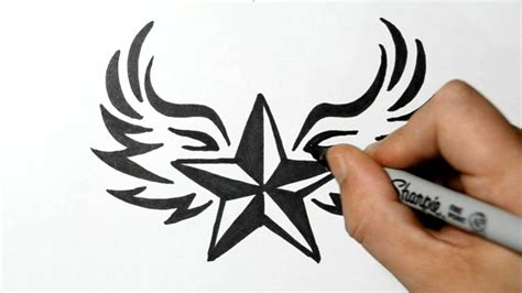 draw  nautical star  wings tribal style