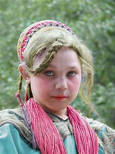 Young Kalash Girl With Blonde Hair And Blue Eyes