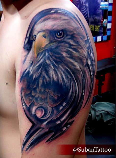 left shoulder grey eagle head tattoo
