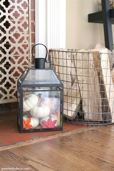 fall living room lantern white pumpkins basket logs gold