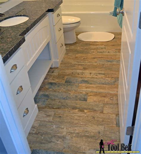 how to lay laminate flooring in bathroom how to install wood tile barnwood her tool belt