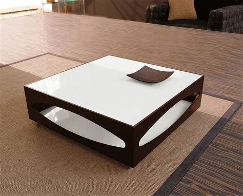 This elegant rectangular coffee table has a top that is made up of frosted lacquered glass inserts, and its wooden body and legs give it an inimitable appeal. The Most Inspired Unique Contemporary Coffee Tables Ideas ...