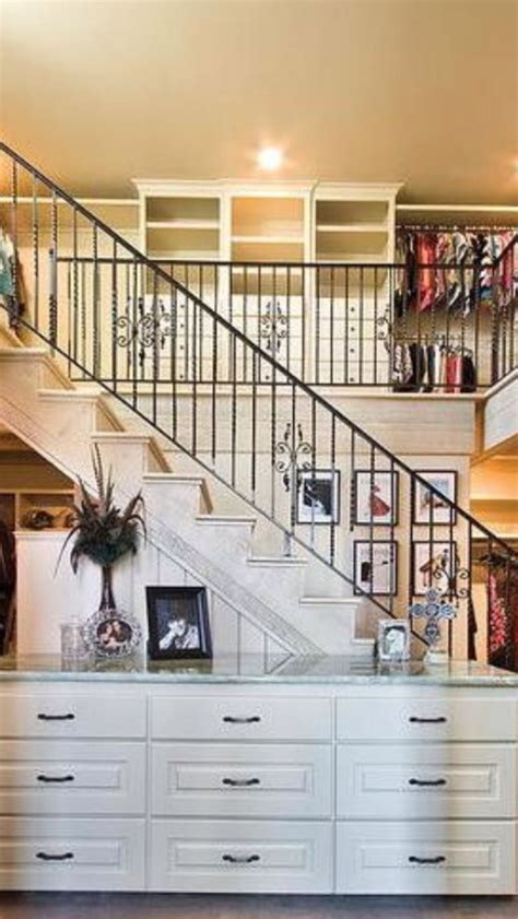"""Two story closet"""" kitchen in front of stairs   round the"""