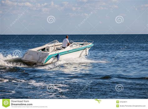 Driving Boat In Dream by Man Driving A Fast Boat Stock Image Image Of Drive Fast
