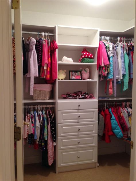 solid wood cabinetery for small walk in closet