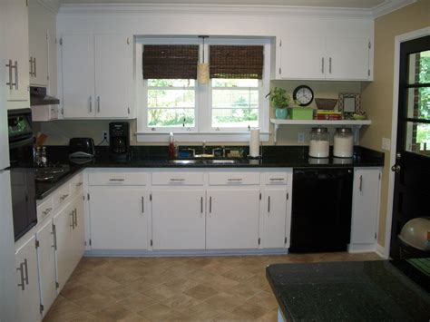 coloured kitchen cabinets ways to achieve the black and white kitchen 6269