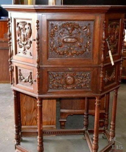 small hand carved mahogany doors antique desk  hidden