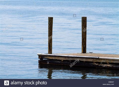 Old Boat Dock by A Single Old Weathered Floating Boat Dock Made Of Wood
