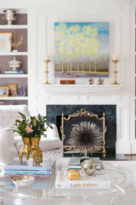 In a perfect world, we'd all have immaculately styled coffee tables —ones with perfect monochrome stacks of fashion books, designer candles, and towering floral arrangements. Ideas For How to Style a Round Coffee Table | Apartment Therapy