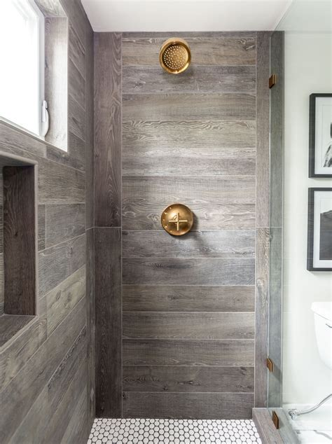 Wood Tiles In Bathroom by Designer Juxtaposed Interiors Luxury Farmhouse Bathroom