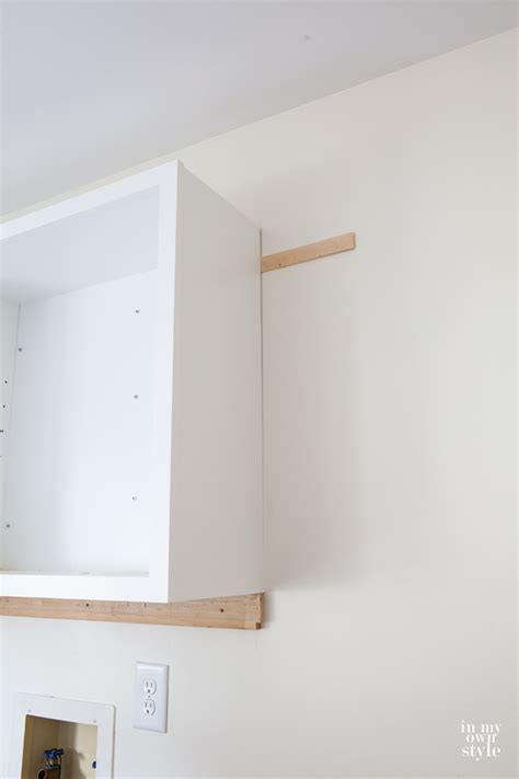 how to hang cabinets mudroom update installing wall cabinets in my own style