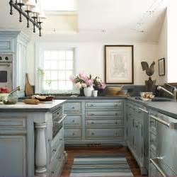 bridge style kitchen faucet gray kitchen cabinets cottage kitchen southern living
