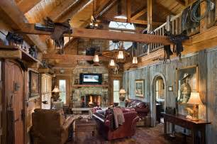 western home interior log home with barn wood and western decor traditional living room louisville by
