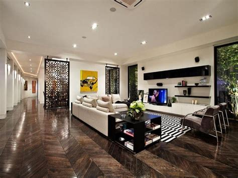 ideas for open plan living areas open plan living room using black colours with hardwood floor to ceiling windows living area