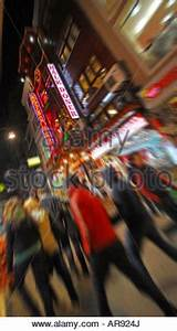 Neon lights from restaurants and bars at dusk in the