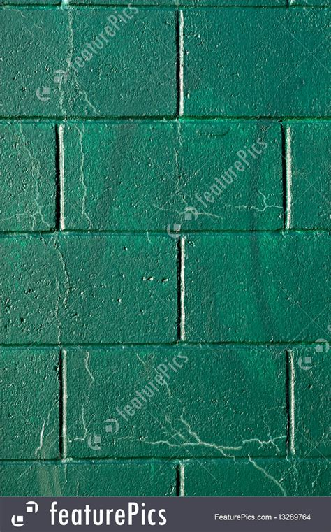 cracked green cynder block wall image