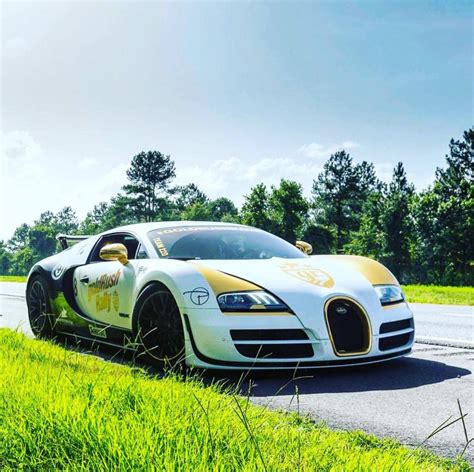 """The bugatti veyron ss, or fully known by it's model name as the bugatti veyron 16.4 super sports 2010 world record edition, is a famous supercar, and sports car model of the car brand, bugatti. Bugatti Veyron Supersport """"Pur Blanc"""" painted in Black & White. Wrapped in Chrome Gold accents ..."""