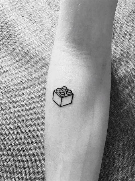Lego brick tattoo   Lego tattoo, Small tattoos, Tattoos